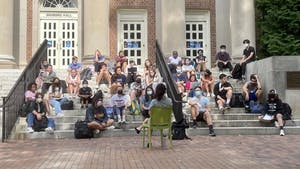 A class meets outside of Manning Hall on Sept. 23, 2021, during a power outage that affected a large portion of North Campus.
