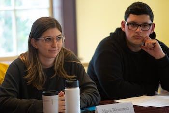 "Law student Maya Weinstein (left) and student Joshua Romero, members of the Campus Safety Commission, listen to remarks during a meeting in Carroll Hall on Wednesday, Jan. 15, 2020, ahead of the Summit of Safety and Belonging. ""I really feel like they created this mostly, and it's not us giving feedback and listening more and putting the Chancellor in the hot seat,"" Weinstein said. ""It does feel more of like a presentation and parade of all these things. And I will accept that for this because we have two weeks."""
