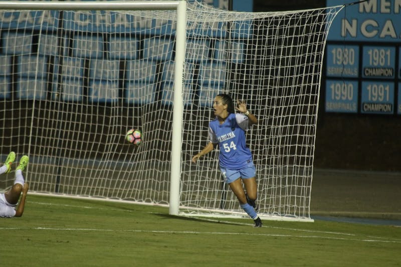 North Carolina forward Sarah Ashley Firstenberg (54) celebrates after heading in UNC'sfirst goal of the season in a 2-0 win over Central Florida.