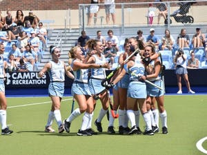 The North Carolina field hockey team celebrates during its 5-1 win against No. 5 Michigan on Aug. 25 at Carolina Field Hockey Stadium.