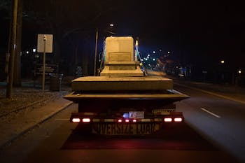 Workers remove the base of Silent Sam, which stood on the campus of UNC-CH for over 100 years, the night of Tuesday, Jan. 14, 2019. The removal of the pedestal came hours after Chancellor Carol Folt announced the removal and her resignation after spring graduation.