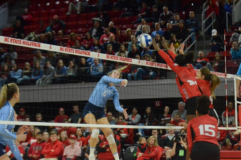 UNC's outside hitter Skylar Wine (6) spikes the ball during the game at N.C. State on Wednesday, Nov. 14. UNC lost to State 3-0.