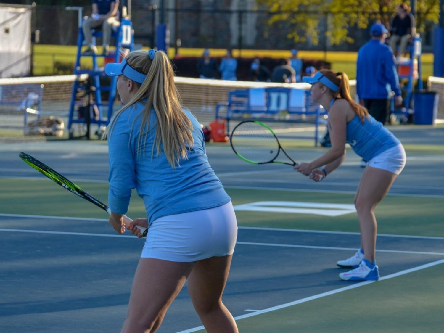 Alle Sanford (left) and Sara Daavetilla (right) await a serve during a Women's doubles match against Duke at Ambler Tennis Center on Friday.