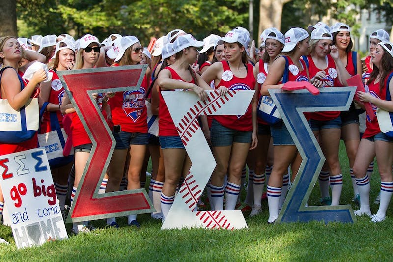 Sigma Sigma Sigma waits to welcome their new members at Bid Day in McCorkle Place.