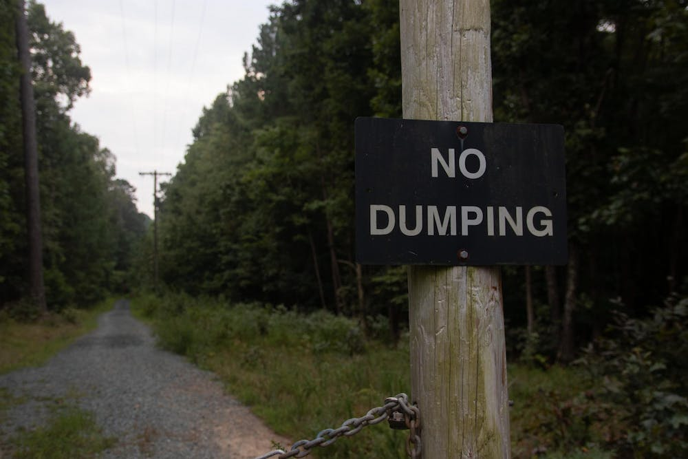 """<p>A """"No Dumping"""" sign is pictured at the Carolina North Forest, a woodland owned by UNC Chapel hill that covers 750 acres and has several hiking trails.&nbsp;</p>"""