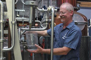 George Dusek is the head distiller at TOPO's distillery, located on the corner of West Franklin and South Graham streets.Distilleries are not allowed to sell liquor after tours under the current system. TOPO owner Scott Maitland drafted a bill to allow this after popular demand.