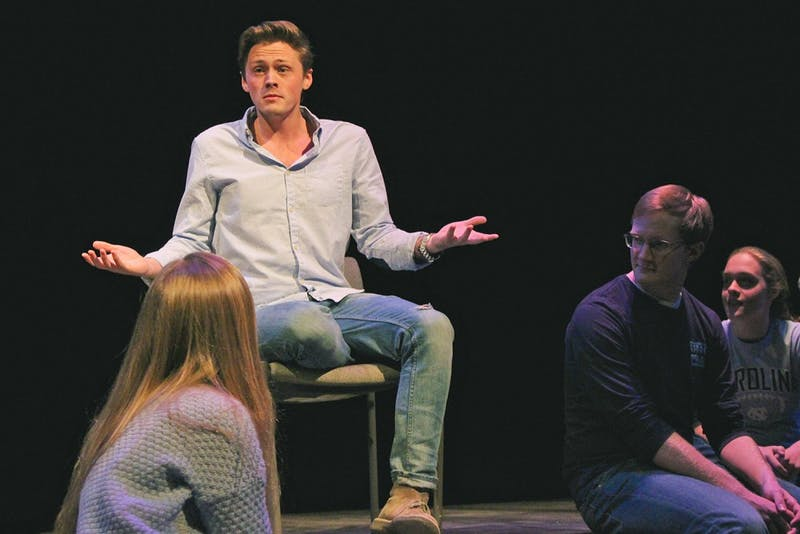 """Christian Payne, asenior dramatic arts and English major,performs """"Just Friends"""" during the UNC-Duke collaboration, theMe Too Monologues."""