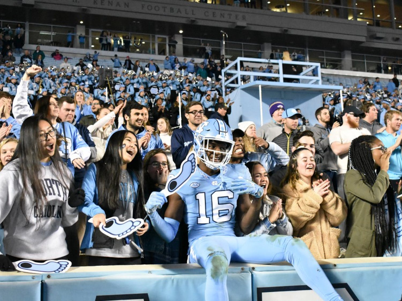 Sophomore safety DJ Ford (16) celebrates with fans after Carolina's 49-26 win over Western Carolina on Saturday, Nov. 17, 2018 in Kenan Memorial Stadium.