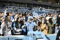 Sophomore safety DJ Ford (16) celebrates with fans after Carolina's 49-26 win over Western Carolina on Saturday, Nov. 17, 2018 in Kenan Memorial Stadium.