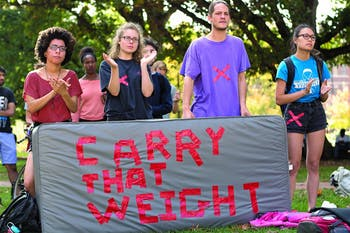 """Student protesters from the """"Carrying the Weight Together,"""" a national effort to bring awareness to sexual assault injustice at colleges,  applaud speeches given at the Wainstein Rally."""