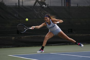 UNC women's tennis junior Alexa Graham prepares to return the ball during her singles match during the ACC Tennis Championships at Cary Indoor Tennis Park in Cary, NC on Sunday April 21, 2019. UNC beat Duke 4-2.