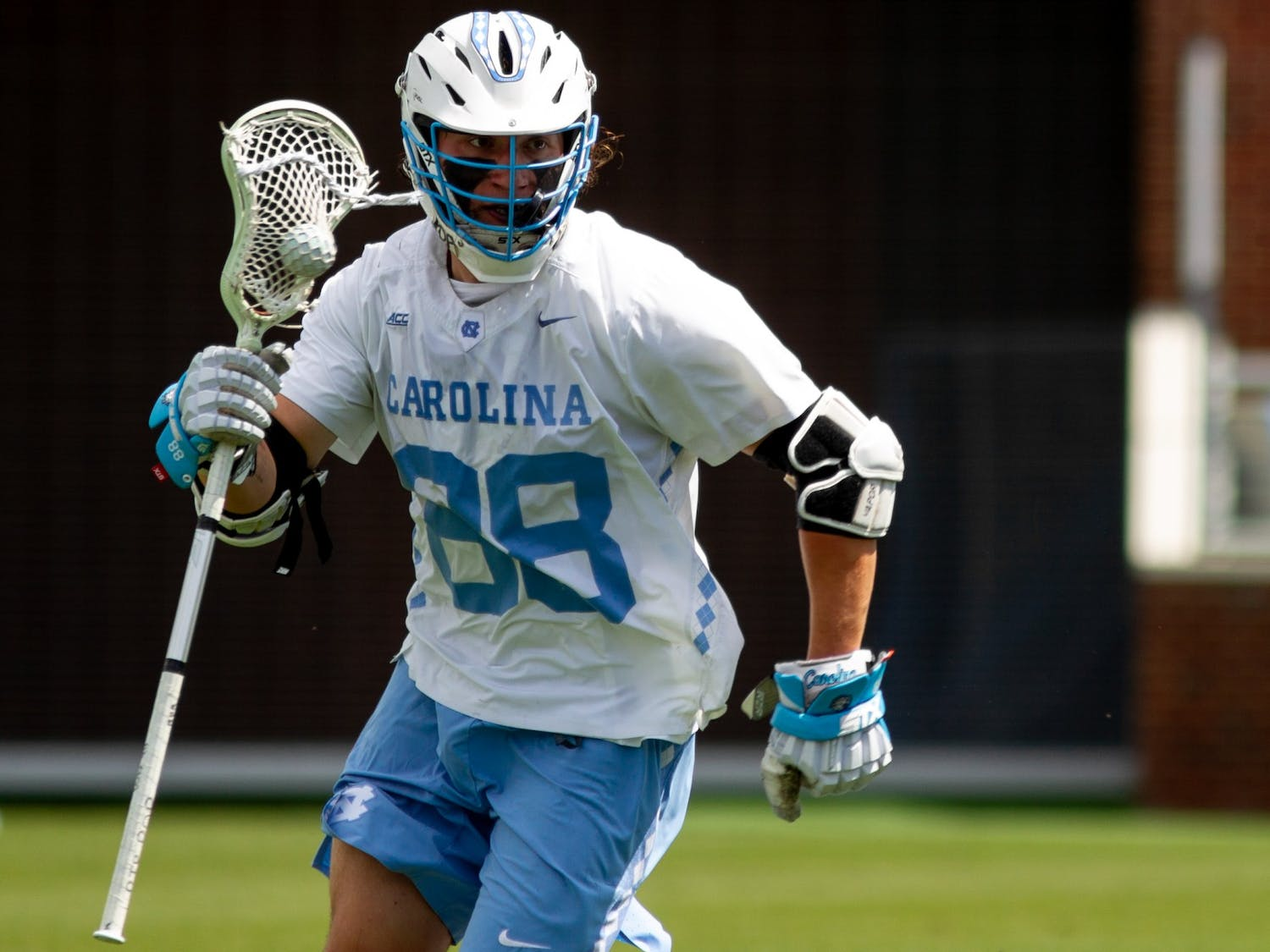 UNC sophomore defensive midfielder Alex Breschi (88) goes on the attack during an 18-16 loss to UVA at Dorrance Field on April 10, 2021.