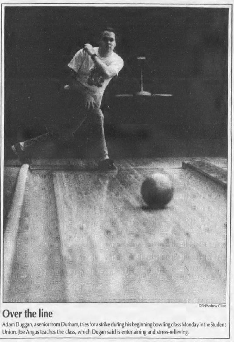 Adam Duggan, a senior from Durham, tries for a strike during his beginning bowling class Monday in the Student Union in 1991. Joe Angus teaches the class, which Duggan says is entertaining and stress-relieving. DTH FILE/Andrew Cline