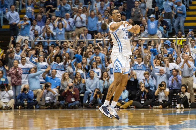 UNC junior forward Garrison Brooks (15) celebrates a successful shot in the Smith Center on Tuesday, March 3, 2020. The Tar Heels beat the Wake Forest Demon Deacons 93-83.