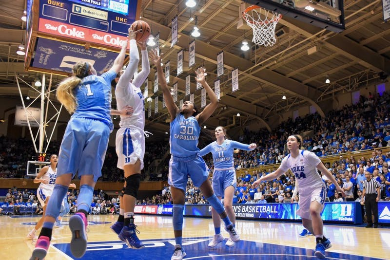 Guard Taylor Koenen (1) attempts to block a shot against Duke on Feb. 25 in Cameron Indoor Stadium.