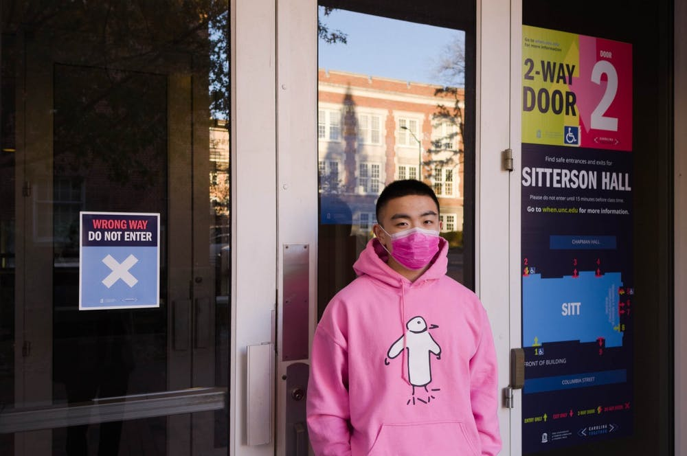 Junior Yang Chen poses for a portrait outside Sitterson Hall on Wednesday, Dec. 2, 2020. Chen is a TA for COMP 110 which is being taught remotely.
