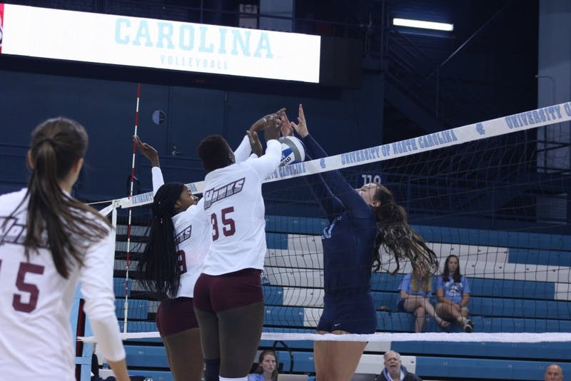 Sophomore setter Hunter Atherton (10) attempts a block against Maryland Eastern Shore in Carmichael Arena on Aug. 31 in the Carolina Classic.