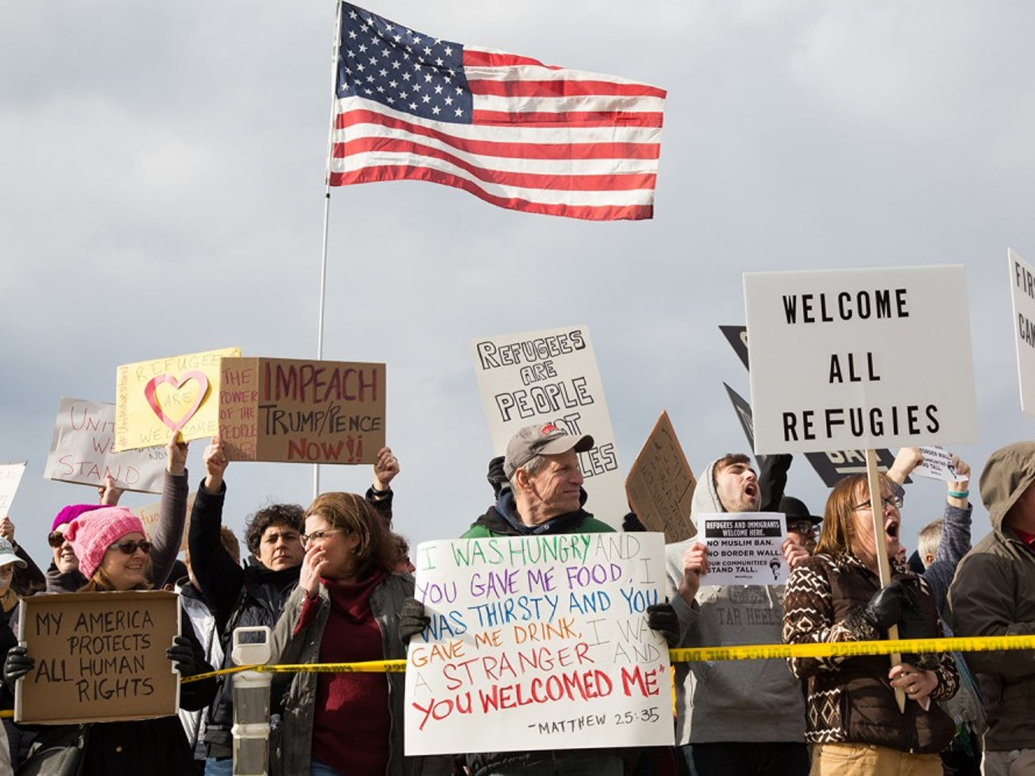 Approximately 1,000 protesters gather outside terminal two at Raleigh-Durham International Airport Sunday in response to President Donald Trump's executive order banning immigrants from certain Muslim-majority countries from entering the U.S.