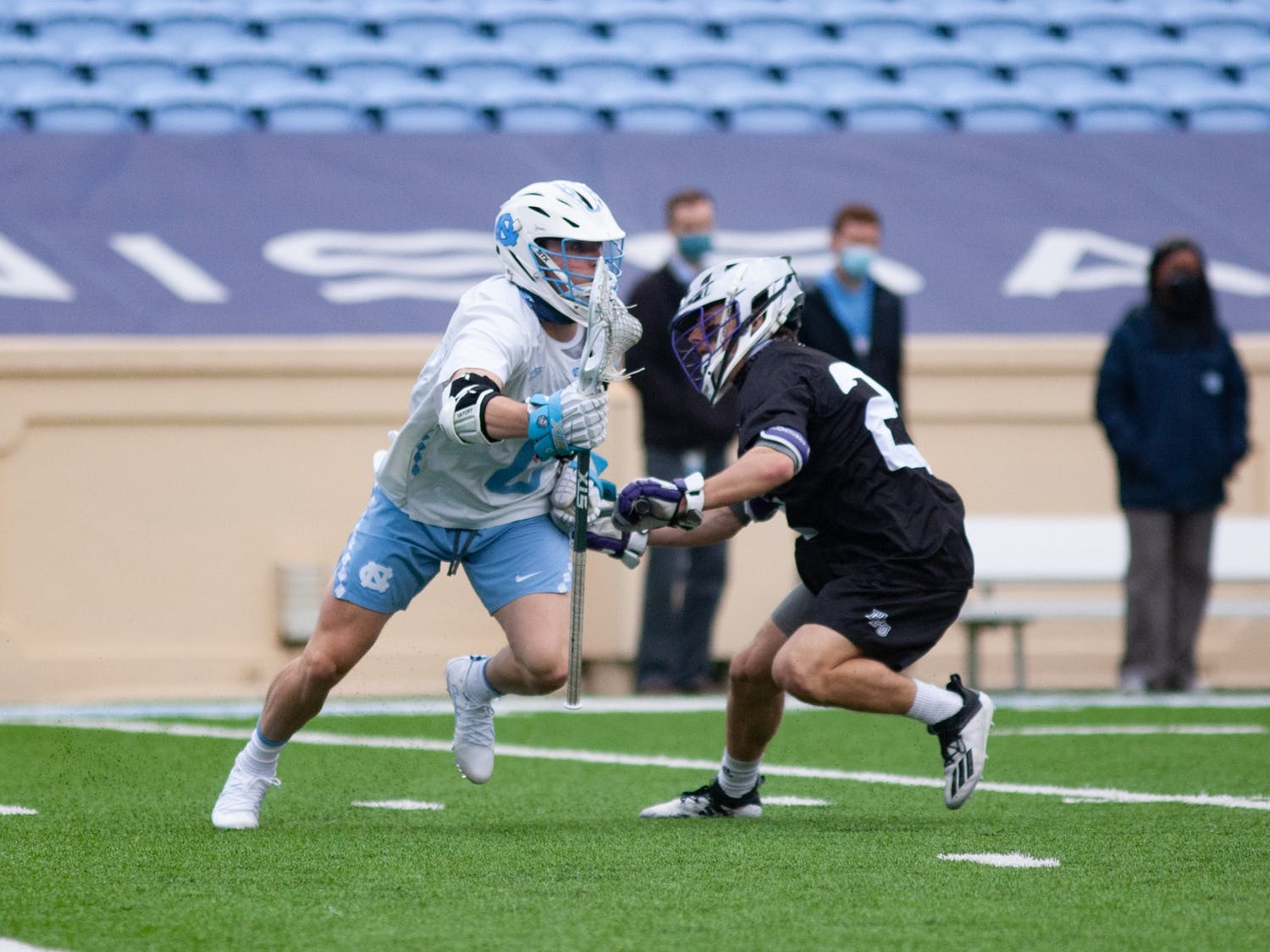 Sophomore attackman, Lance Tillman (0) tries to get around a High Point opponent. UNC wins against High Point 27-12 at Kenan Stadium on Saturday, Feb. 27, 2021.