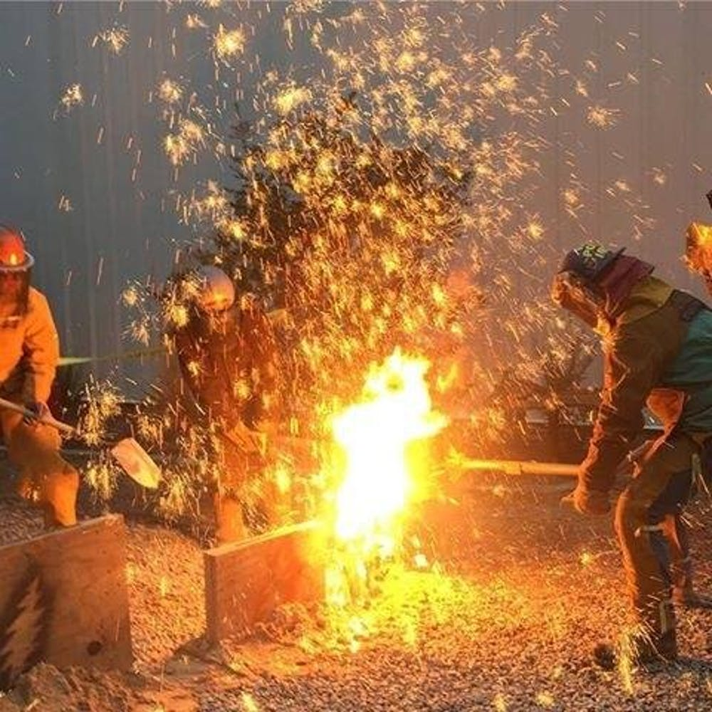 Fire-breathing and 3,000-degree art at third annual Iron Pour