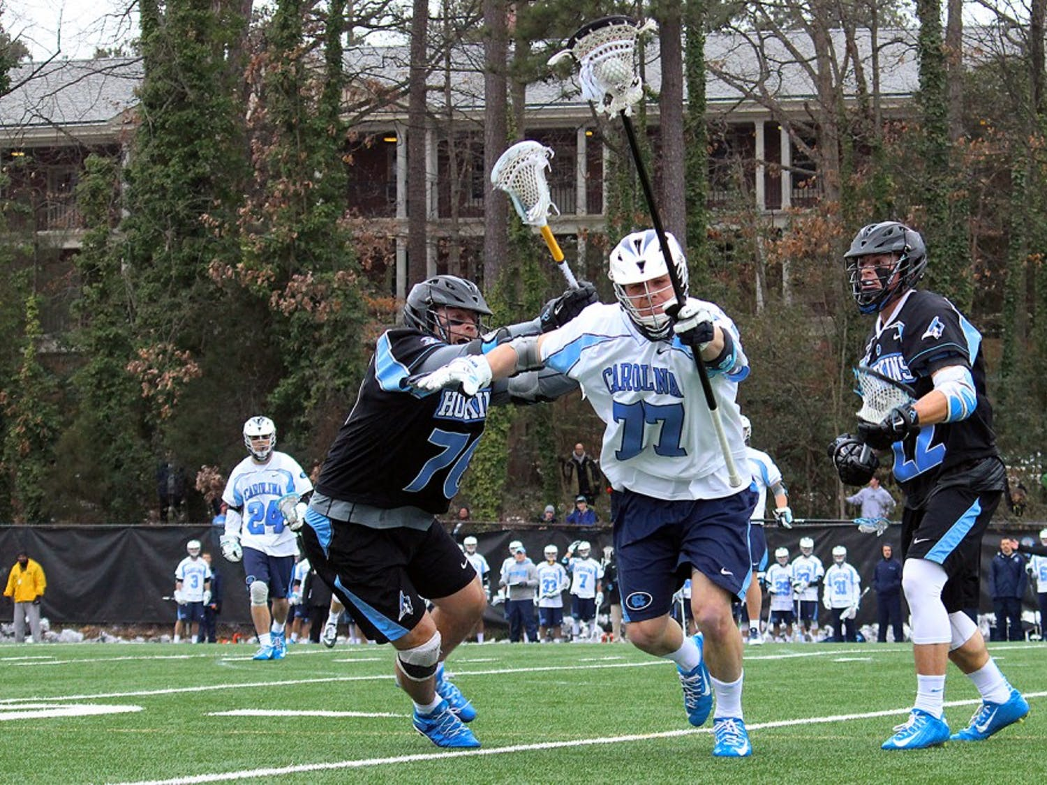 Junior defenseman Zach Powers (77) carries the ball down the field.