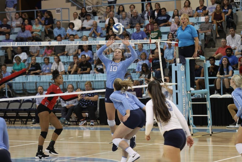 Hunter Atherton, sophomore setter for UNC's women's volleyball team, sets the ball for her teammate in a game against N.C. State on Wednesday, Sept. 26, 2018.