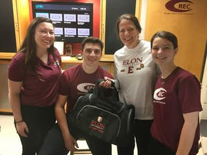 Elon University President Connie Book poses with students at the university's Campus Recreation center on her first day as president March 1. Book is Elon's first female president. Photo courtesy of Elon University.