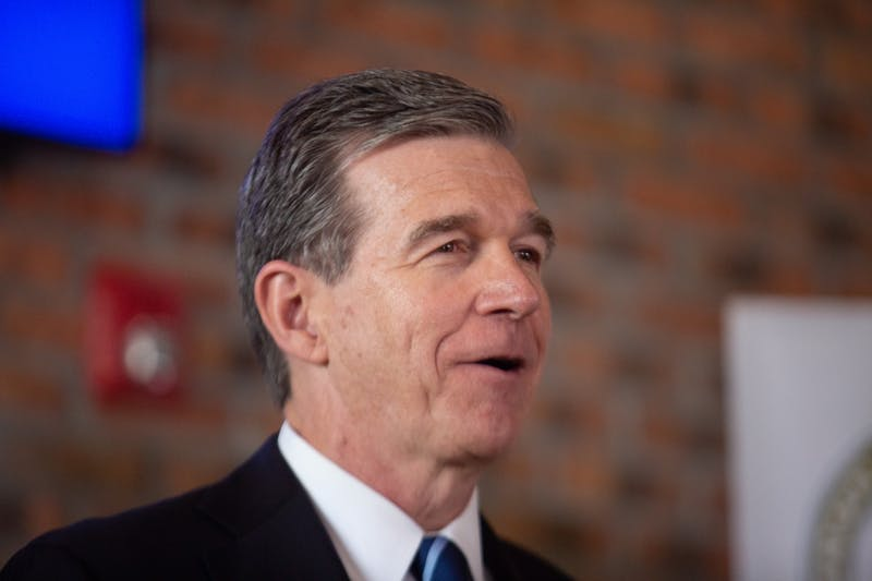 "Gov. Roy Cooper speaks during a press conference unveiling health technology company Well Dot Inc. in Chapel Hill on Tuesday, Nov. 19, 2019. ""We're going to commit to them that we're going to invest in education from cradle to career because we know the importance of education,"" Cooper said."