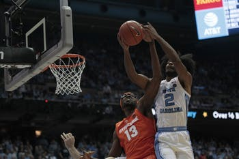 First-year guard Coby White (2) gets a rebound during game against Syracuse in the Smith Center on Tuesday, Feb. 26, 2019. UNC beat Syracuse 93-85.