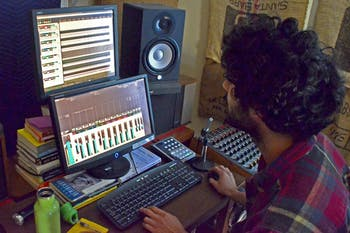 Owner Saman Khoujinian mixes sound in the control room at Sleepy Cat Studios in Carrboro.