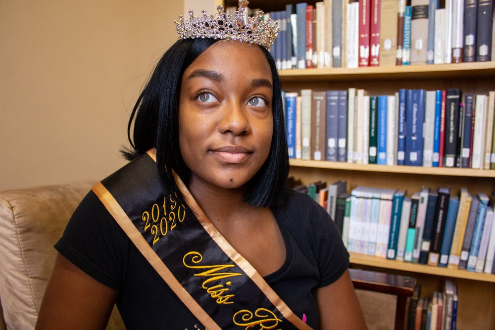 Reana Johnson, a senior communications major, poses with her crown and sash in Ullman Library on Tuesday, Jan. 14, 2020. Johnson was crowned Miss Black and Gold 2019-2020 by Alpha Phi Alpha Fraternity Inc. Mu Zeta Chapter.