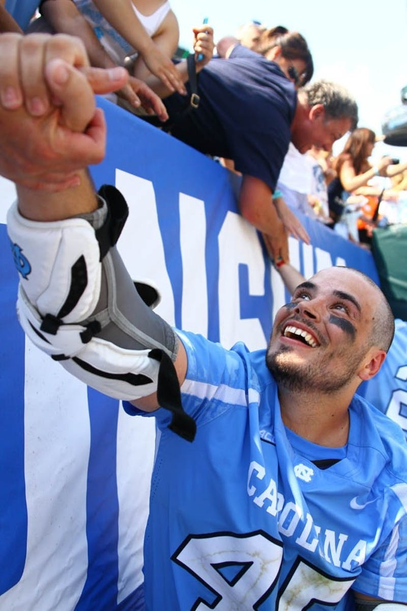 Chris Cloutier meets with fans after UNC's semifinal win during the 2016 NCAA Tournament.