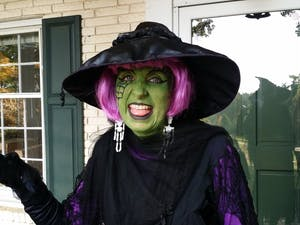 Farmer Cindy Stubbs dressed as a witch at Firefly Farm. Photo courtesy of Firefly Farm's Facebook page.