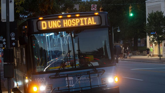 A Chapel Hill Transit bus on the D Route at a bus stop on Franklin Street on Wednesday, Aug. 26, 2020.