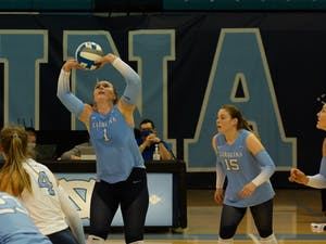 UNC graduate setter Meghan Neelon (1) sets the ball during a home volleyball game against the University of Virginia on Sept. 26 in Carmichael Arena.