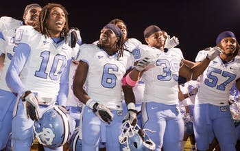 Tre Boston, Anthony Elzy, Kenny owens and dion guy celebrate North Carolina's 44-10 victory at Virginia. The Tar Heels intercepted five UVa. passes and had just one turnover.