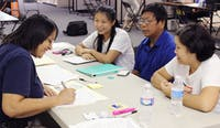 Hnin Wai and Myint and Aye Thaung attend the Disaster Assistance Center set up in University Mall this week.