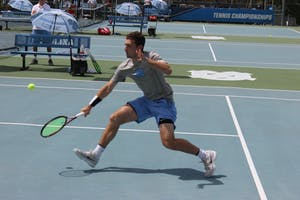 Sophomore Will Blumberg returns a serve against his Georgia Tech opponent on April 14 at the Cone-Kenfield Tennis Center.