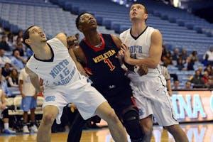 The Wesleyan Christian Academy men's basketball team defeated UNC's junior varsity team Saturday morning.