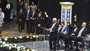 Roy Williams honors Dean Smith's legendary concept of pointing to the passer during the memorial service for Smith on Sunday in the Smith Center.