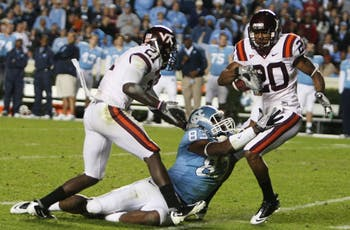 Jayron Hosley (20) comes up with one of four Virginia Tech interceptions on Saturday. Dwight Jones (83) tallied only one catch after being the team's top wide receiver as of late.