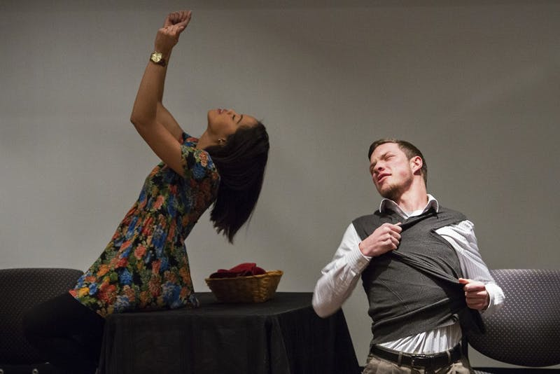 "Cara Pugh, left, and Noah Boyd perform a skit on gender roles Monday evening for ""What Are You Looking At?,"" a performance and facilitated discussion program about media literacy and body image issues across gender and race."