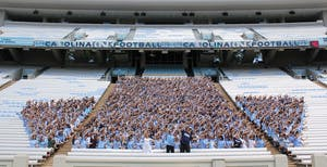 "Several hundred members of the class of 2016 wore Carolina blue and met in Kenan Stadium on Sunday afternoon to take an inaugural ""First-Year Photo."""