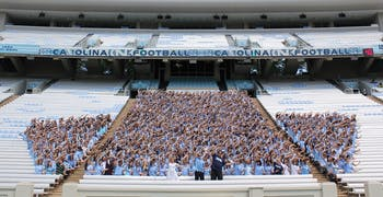 """Several hundred members of the class of 2016 wore Carolina blue and met in Kenan Stadium on Sunday afternoon to take an inaugural """"First-Year Photo."""""""
