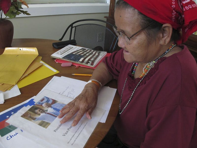 Sey Mor practices identifying the President and Vice President at a citizenship class at the Refugee Support Center of Carrboro. Sey Mor is a refugee from Burma living in Carrboro.