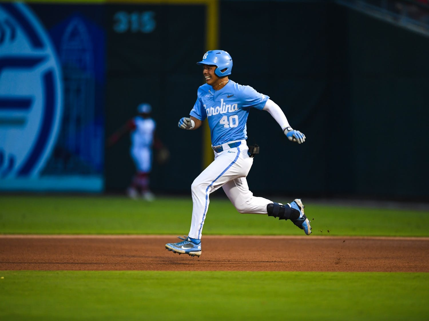 UNC redshirt sophomore outfielder Angel Zarate (40) runs to a base at the ACC tournament game against NC State on Friday May 28, 2021 in Charlotte, NC. UNC won 9-6. Photo courtesy of Maggie Boulton and Laura Wolff.