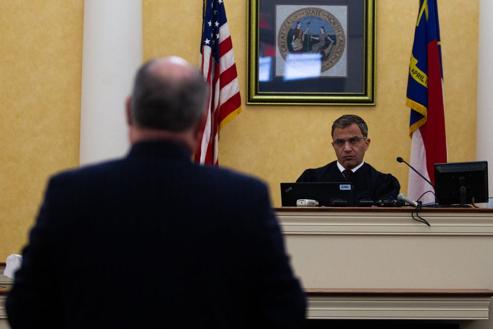 <p>Judge Allen Baddour looks on as Sons of Confederate Veterans Inc's lawyer Boyd Sturges speaks during a hearing in the Orange County Courthouse in Hillsborough on Wednesday, Feb. 12, 2020.&nbsp;</p>