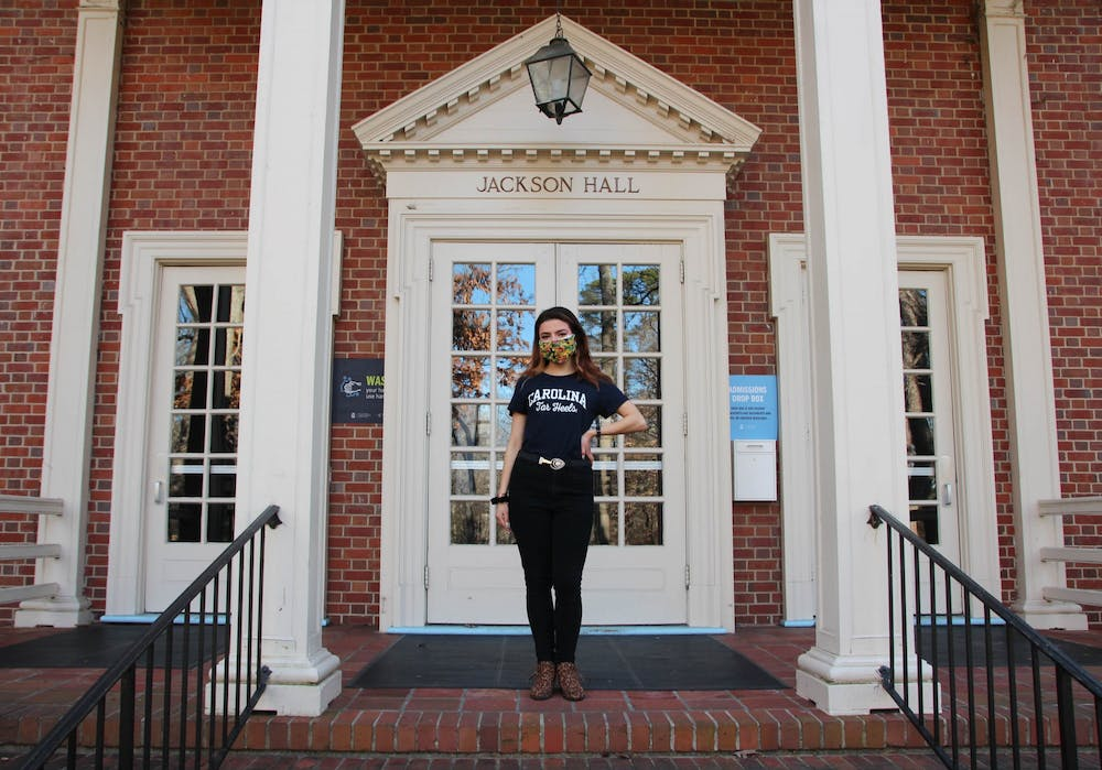 Admissions Ambassador Gabriela Duncan poses for a portrait outside of Jackson Hall on Feb. 17, 2021. Duncan gives virtual tours of the UNC campus to prospective students.