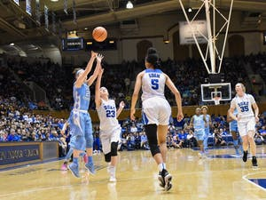 Guard Leah Church (20) shoots a 3 pointer against Duke on Feb. 25 at Cameron Indoor Stadium.