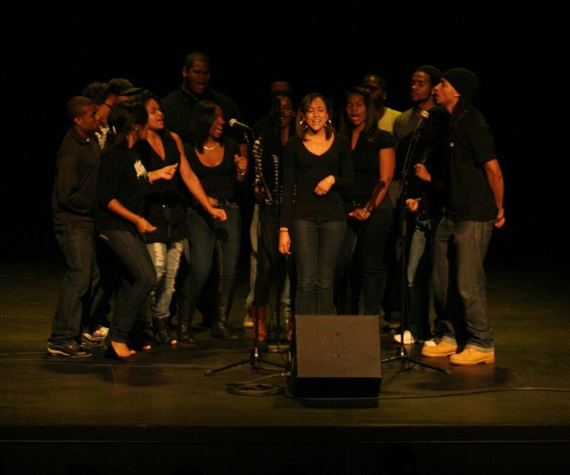 A cappella group Harmonyx performs a song for the reopening of the Historic Playmakers Theatre on Tuesday. The night was celebrated with poetry readings put on by CUAB, Ebony Readers Onyx Theater and others. Def Jam poet Shihan Van Clief presented open-mic poets.